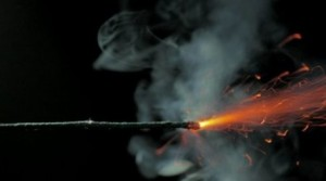 stock-footage-igniting-a-dynamite-fuse-with-a-match-close-up-p-e1333973037788